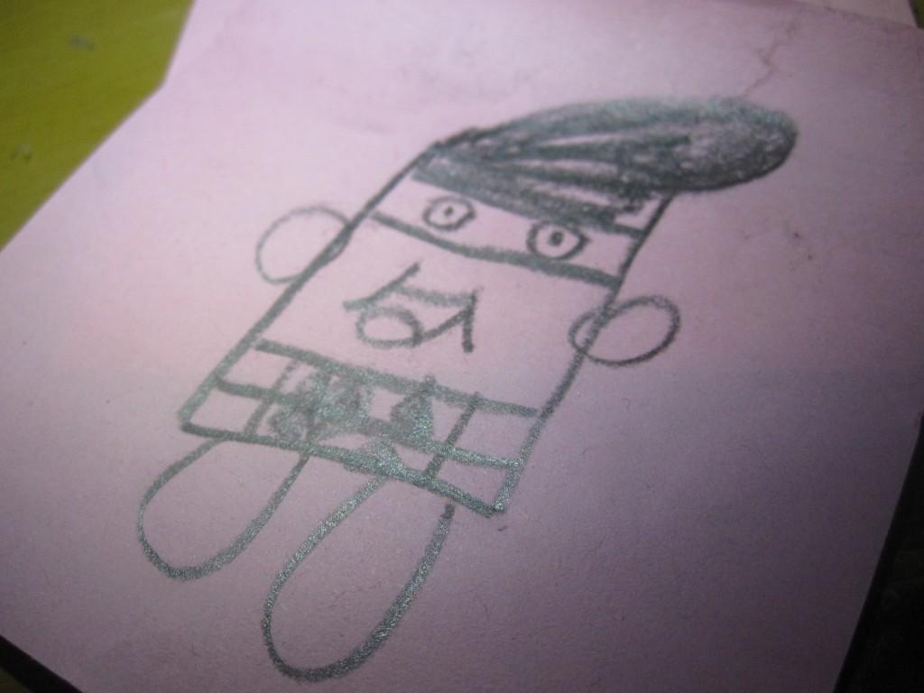 謎のキャラクターが描かれたメモ用紙