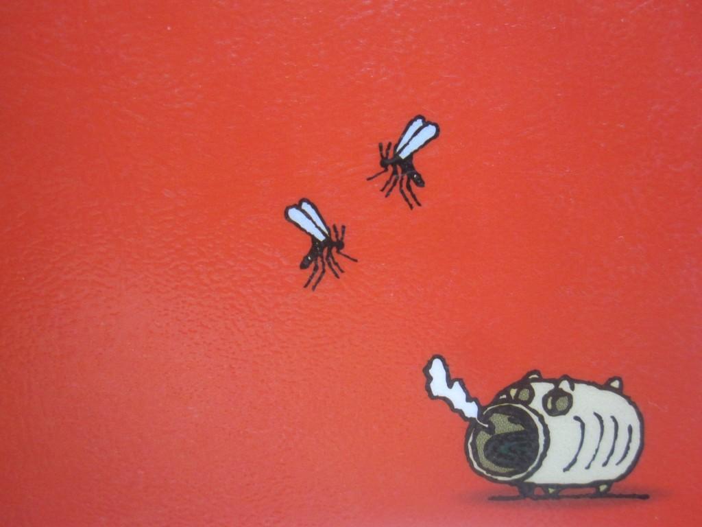 蚊遣り豚と飛んでいる蚊