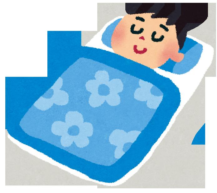 布団に横になり眠り始める男性
